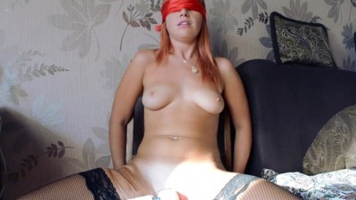 Red-haired chick tries out her new toy