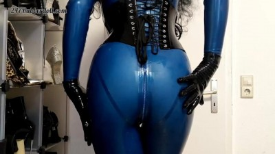 Mistress Posing in Blue Latex Catsuit